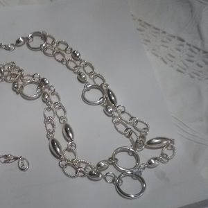 Multiple strand silver tone necklace and earrings
